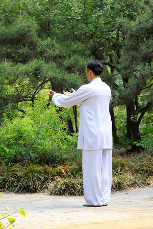 TANGSHAN - MAY 10: elderly practicing martial arts in a park on May 10, 2014, tangshan city, hebei province, China.  Stock Photo - 28690348