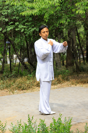 TANGSHAN - MAY 10: elderly practicing martial arts in a park on May 10, 2014, tangshan city, hebei province, China. 