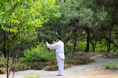 TANGSHAN - MAY 10: elderly practicing martial arts in a park on May 10, 2014, tangshan city, hebei province, China.  Stock Photo - 28692018