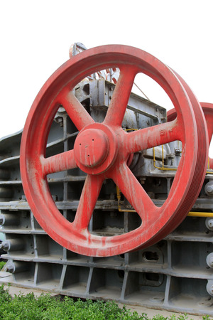 industrial park: big red metal wheels in an industrial park, closeup of photo