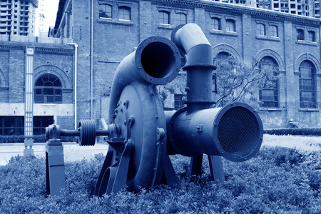 industrial park: huge gray mechanical equipment in an industrial park, closeup of photo