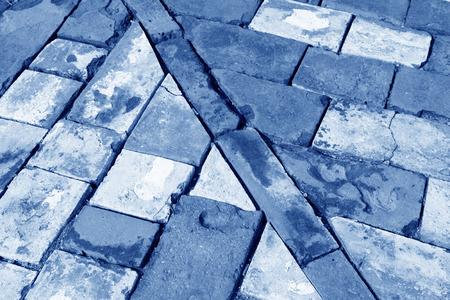 restore ancient ways: Broken blue bricks on the ground, closeup of photo
