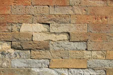 restore ancient ways: debris gray brick wall, closeup of photo