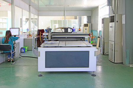 ink jet: TANGSHAN CITY - MAY 28: Large ink jet printers in a production workshop, on may 28, 2014, Tangshan city, Hebei Province, China