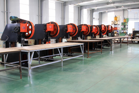 punch press: TANGSHAN CITY - MAY 29: Rows of mechanical equipment on production line in a factory, on may 29, 2014, Tangshan city, Hebei Province, China  Editorial
