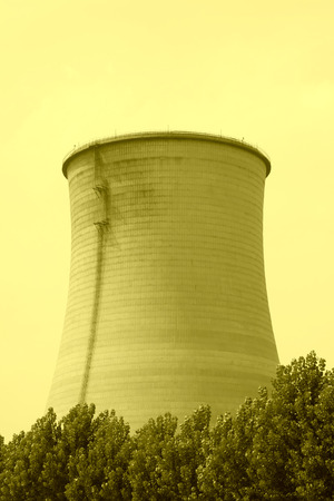 cooling tower: heavy industrial water cooling tower and the green tree, north china