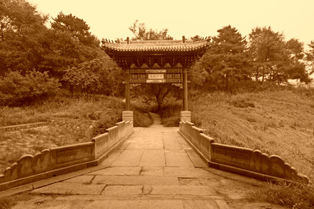 stone archway and stone bridge at a Chinese ancient garden