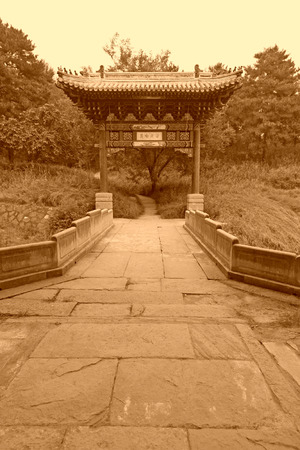analogy: stone archway and stone bridge at a Chinese ancient garden