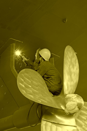 industrial workers welding ship propeller, north china photo