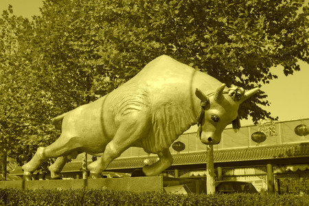 bull sculpture in a park, north china photo