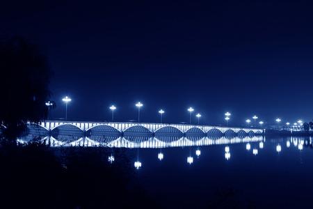 brilliantly: brilliantly illuminated bridge in the river at night, north china Stock Photo