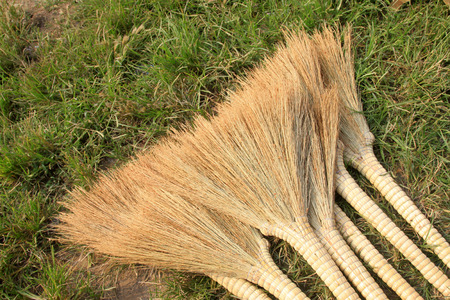 strong toughness: broom on the market in the countryside, closeup of photo