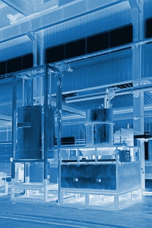 filling equipment: manufacturing production line filling equipment in a workshop Editorial