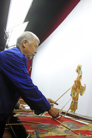 nonphysical: LUANNAN COUNTY- OCTOBER 2: Chinese shadow play performances scene, on october 2, 2014, Luannan, Hebei Province, china.