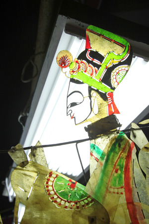 nonphysical: Chinese shadow play props in bright light, closeup of photo Stock Photo