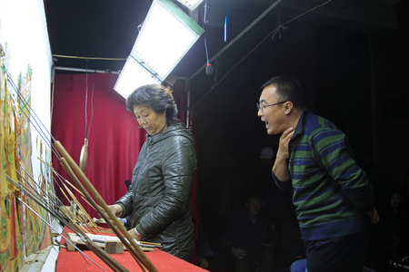 nonphysical: LUANNAN COUNTY- OCTOBER 3: Chinese shadow play performances scene, an artist grabbed his throat to sing, on october 3, 2014, Luannan, Hebei Province, china. Editorial