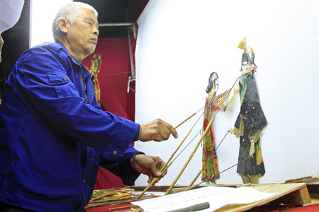 nonphysical: LUANNAN COUNTY- OCTOBER 3: Chinese shadow play performances scene, on october 3, 2014, Luannan, Hebei Province, china. Editorial