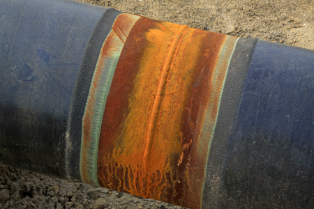 peeling rubber: Black metal pipe, closeup of photo Stock Photo