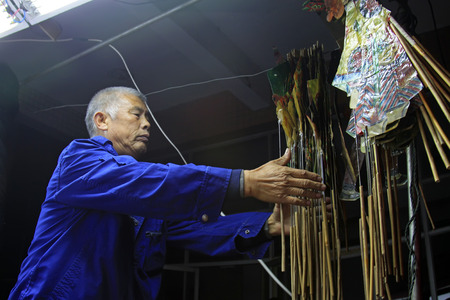 nonphysical: LUANNAN COUNTY- OCTOBER 3: Shadow puppet artists arranging props, on october 3, 2014, Luannan, Hebei Province, china.