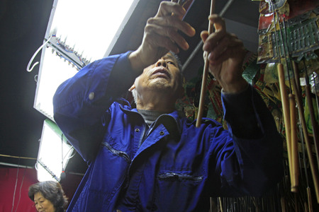 shadow puppet: LUANNAN COUNTY- OCTOBER 2: Shadow puppet artists arranging props, on october 2, 2014, Luannan, Hebei Province, china.