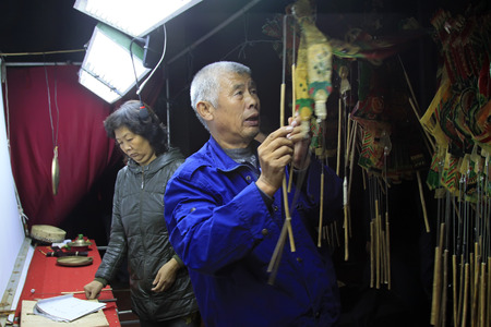 nonphysical: LUANNAN COUNTY- OCTOBER 2: Shadow puppet artists arranging props, on october 2, 2014, Luannan, Hebei Province, china.