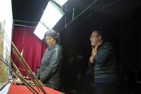 nonphysical: LUANNAN COUNTY- OCTOBER 3: Chinese shadow performances scene, an artist grabbed his throat to sing, on october 3, 2014, Luannan, Hebei Province, china. Editorial