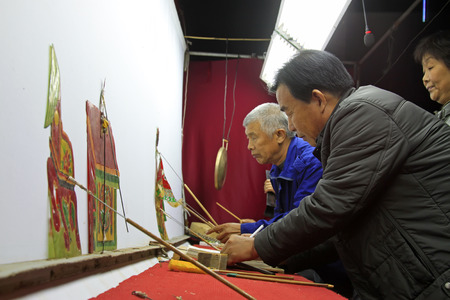nonphysical: LUANNAN COUNTY- OCTOBER 3: Chinese shadow performances scene, on october 3, 2014, Luannan, Hebei Province, china.