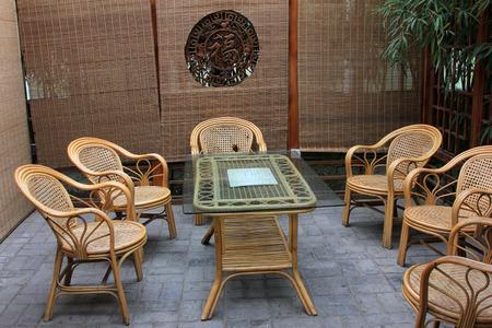 tea table: Bamboo chair and glass tea table, closeup photo Editorial