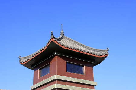 architectural style: Chinese architectural style tower under blue sky, closeup photo Stock Photo