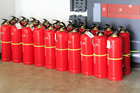 fire extinguishers: TANGSHAN CITY-  NOVEMBER 18: Rows of fire extinguishers in a museum, on november 18, 2014, Tangshan City, Hebei province, China