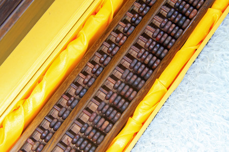 meticulous: Chinese style wooden abacus, closeup of photo Stock Photo