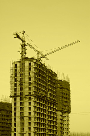 unfinished building: tower crane and unfinished building, China Stock Photo