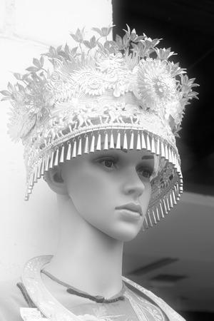 miao: Phoenix County, April 15: A model wearing Miao silver jewelry on April 15, 2012, Phoenix County, Hunan Province, China Editorial