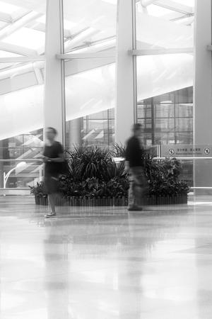 hurrying: Beijing Capital International Airport hall hurrying tourists Editorial