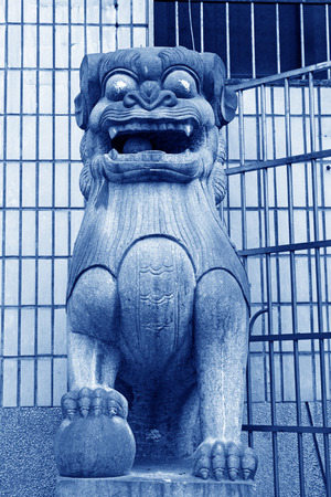 stone carving: gray lion stone carving at the street, south china Stock Photo