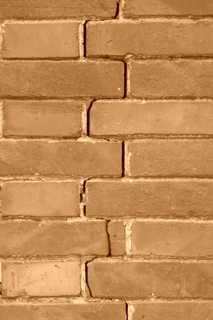 sabotage: closeup of pictures, crack of red brick wall, north china Stock Photo