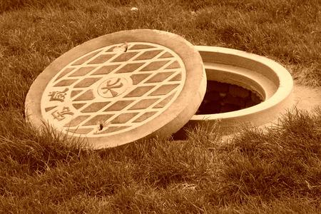 municipal: Municipal sewage manhole cover in a park north china