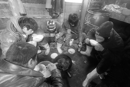 fishing cabin: Luannan County, April 1: Workers were having lunch in the cabin of fishing boat in the ZuiDong fishing Wharf on April 1, 2012, Luannan County, Hebei Province, China.
