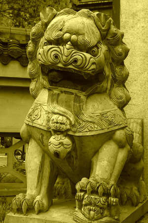 stone carving: gray lion stone carving at the entrance of a temple, china Stock Photo
