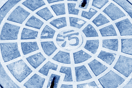manhole cover: metal catch basin manhole cover in the street in China