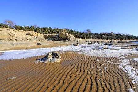 rare rocks: rock and ice in beach, closeup of photo