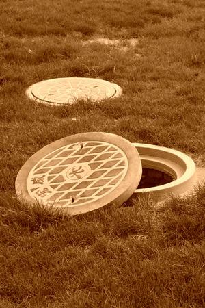 manhole: Municipal sewage manhole cover in a park north china