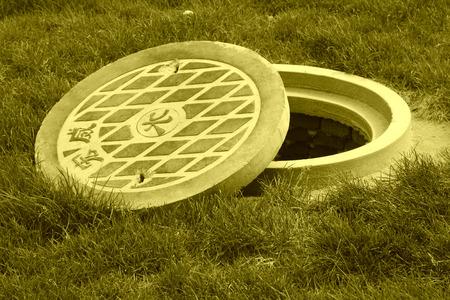 manhole cover: Municipal sewage manhole cover in a park north china