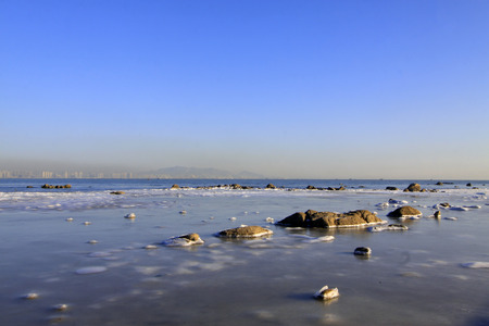 rare rocks: ice and snow natural landscape by the sea, closeup of photo