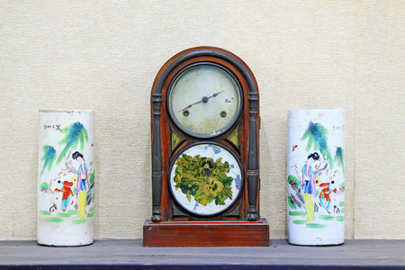 ceramic bottle: Chinese traditional clocks and ceramic bottle, closeup of photo