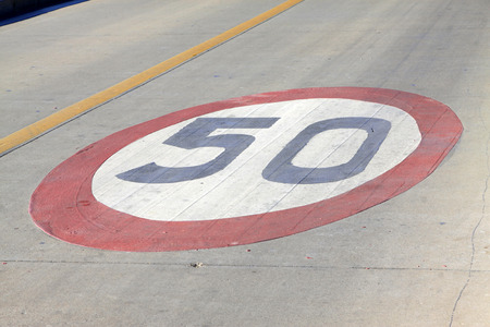 elliptic: 50 kilometers per hour sign on the road in a city