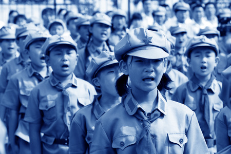 swear: Elementary student dressed in blue military uniform and swear solemnly