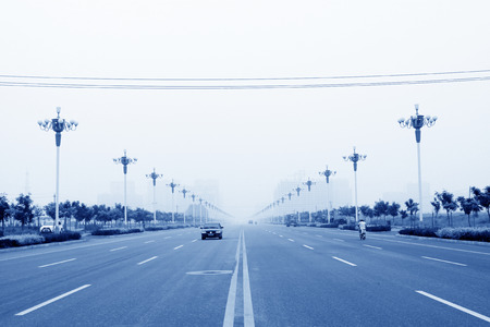 city road: City Road Landscape in the mist, northern china Editorial