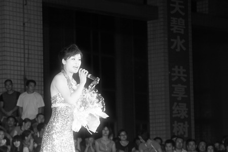 tangshan city: Tangshan City, July 28: Singing performance in the summer evening on July 28, 2012, Tangshan City, Hebei Province, China. Editorial