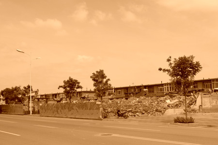 Luannan County, July 30: House demolition site and iron plate fence on July 30, 2012, Luannan, Hebei, China. photo